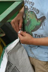 Everett opening up a seed corn bag-Plant 2014