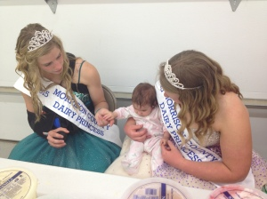 Vivian getting pointers from the Dairy Princesses